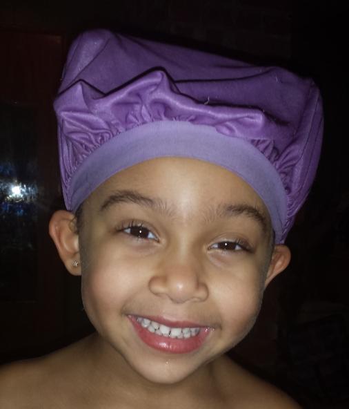 Looking goofy in her satin sleeping cap.